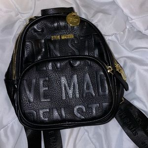 black steve madden mini backpack with gold accents